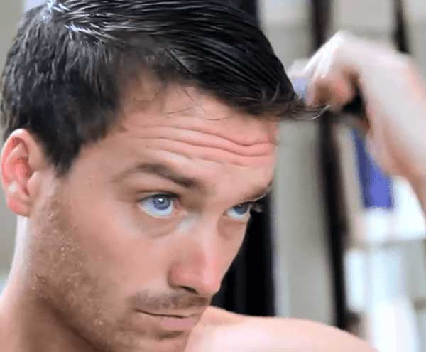 Man Applying Regaine onto Hair